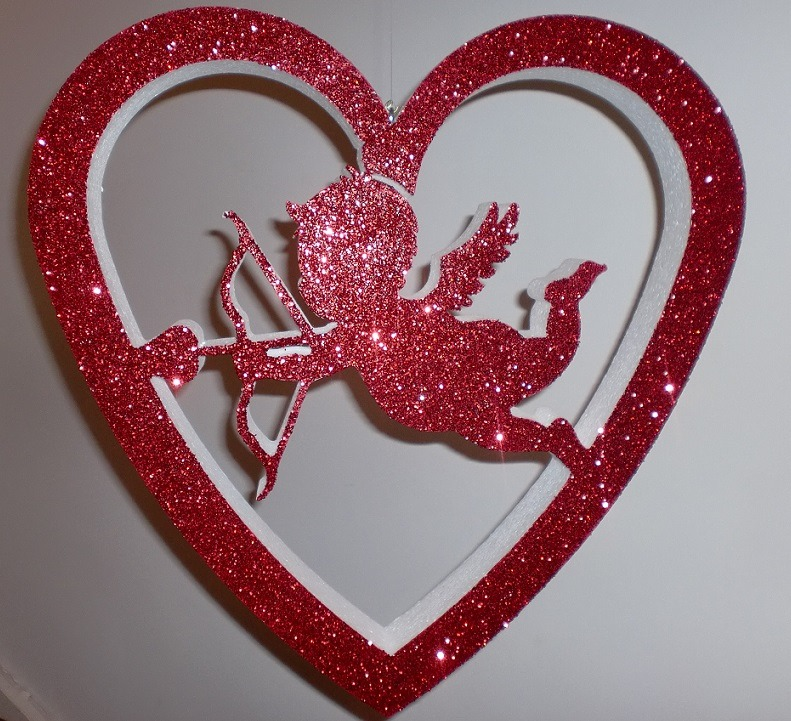 flying cupid in glitter heart